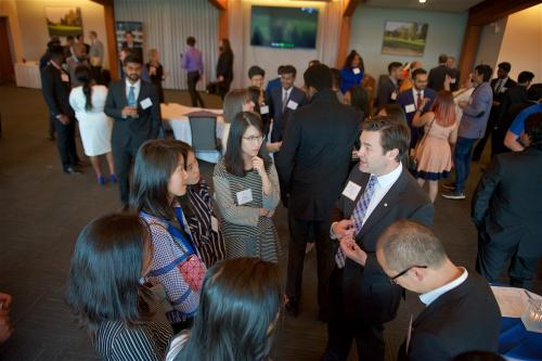 A large group of employers and students at an MBA networking event
