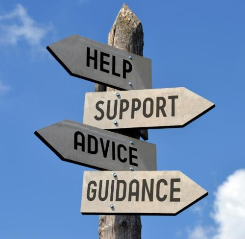 """A sign post with directional signs reading """"Help, Support, Advice and Guidance"""""""