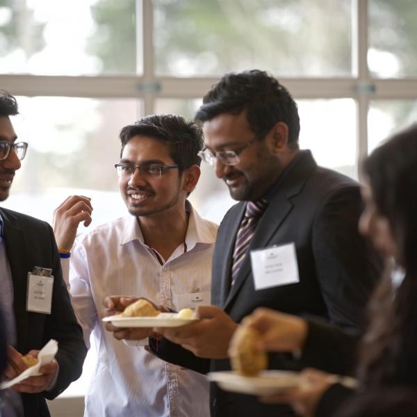 MBA internship students talking at the 2019 Multicultural Tea