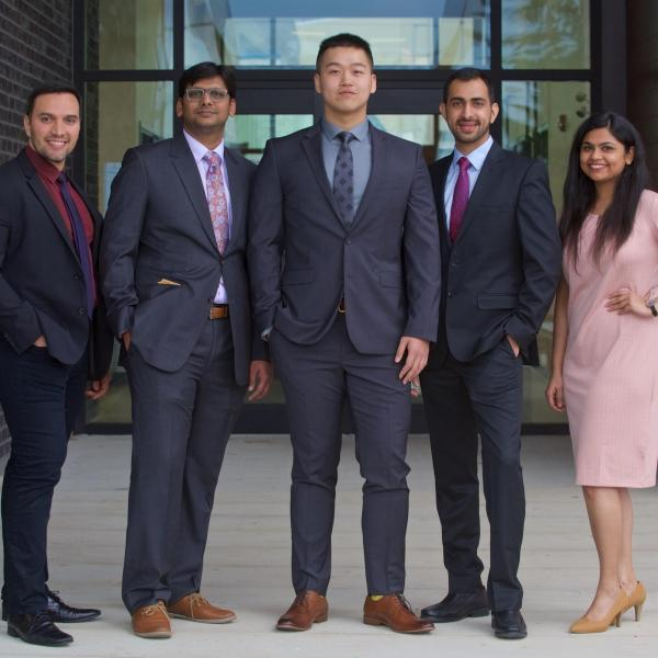 Five MBA internship students posing outside the 2019 Multicultural Tea