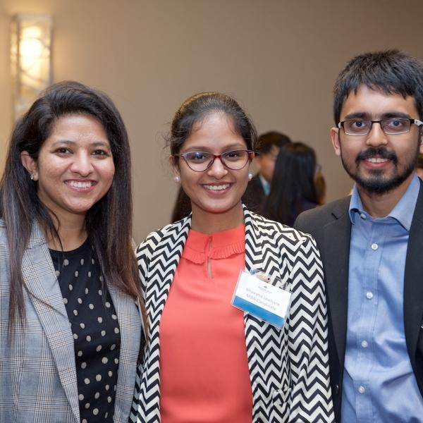 Three MBA internship students at the 2019 Business Mixer at the Coast Bastion Hotel