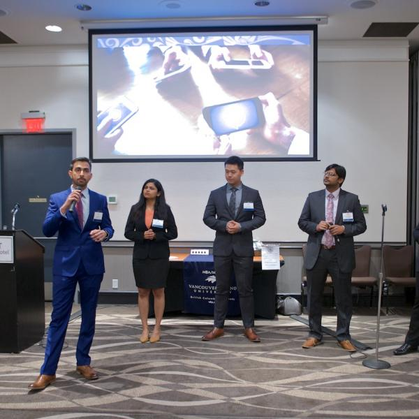 MBA internship students presenting their PechaKucha at the 2019 Business Mixer at the Coast Bastion Hotel