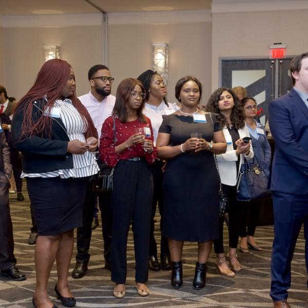 MBA internship students watching their peers present their PechaKucha at the 2019 Business Mixer at the Coast Bastion Hotel