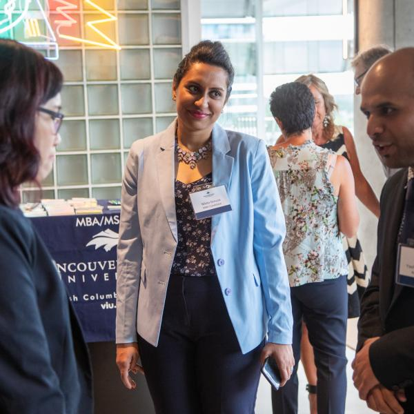 An employer talking to two students at the 2019 FAB 40 event in Vancouver