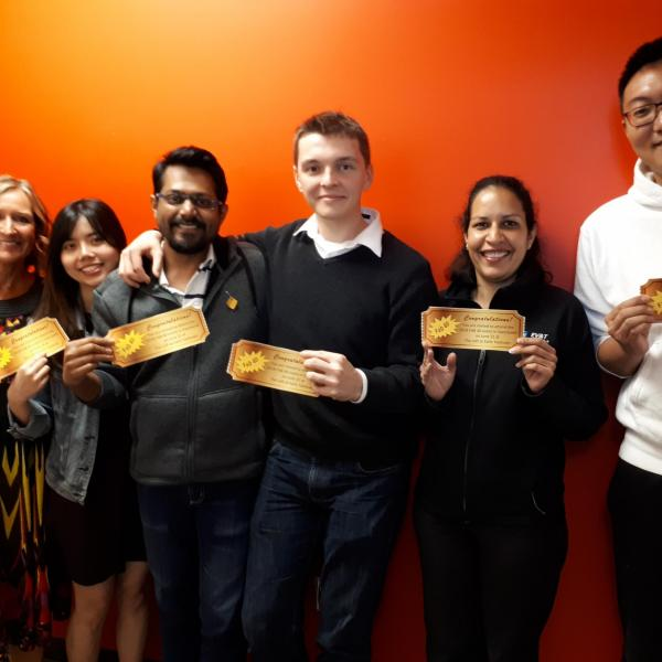 Five MBA FAB 40 goldern ticket winners posing for a picture with their goldern tickets