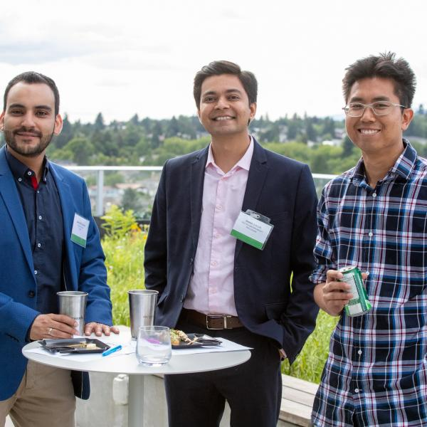 Three MBA students at the 2019 FAB 40 event in Vancouver