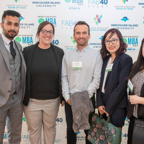 Five MBA student posing for a picture at the 2019 FAB 40 event in Vancouver