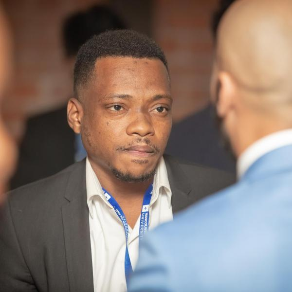 A student talking to an employer at the 2018 FAB 40 event