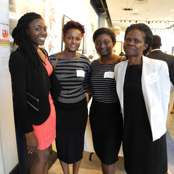 Four MBA students posting for a photo at the 2017 MBA Business Mixer