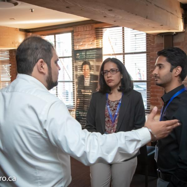 An employer talking to two MBA students at the 2018 FAB 40 event.