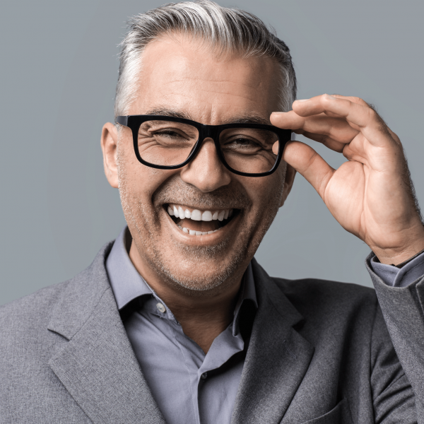 A smiling employer wearing a suit and glasses