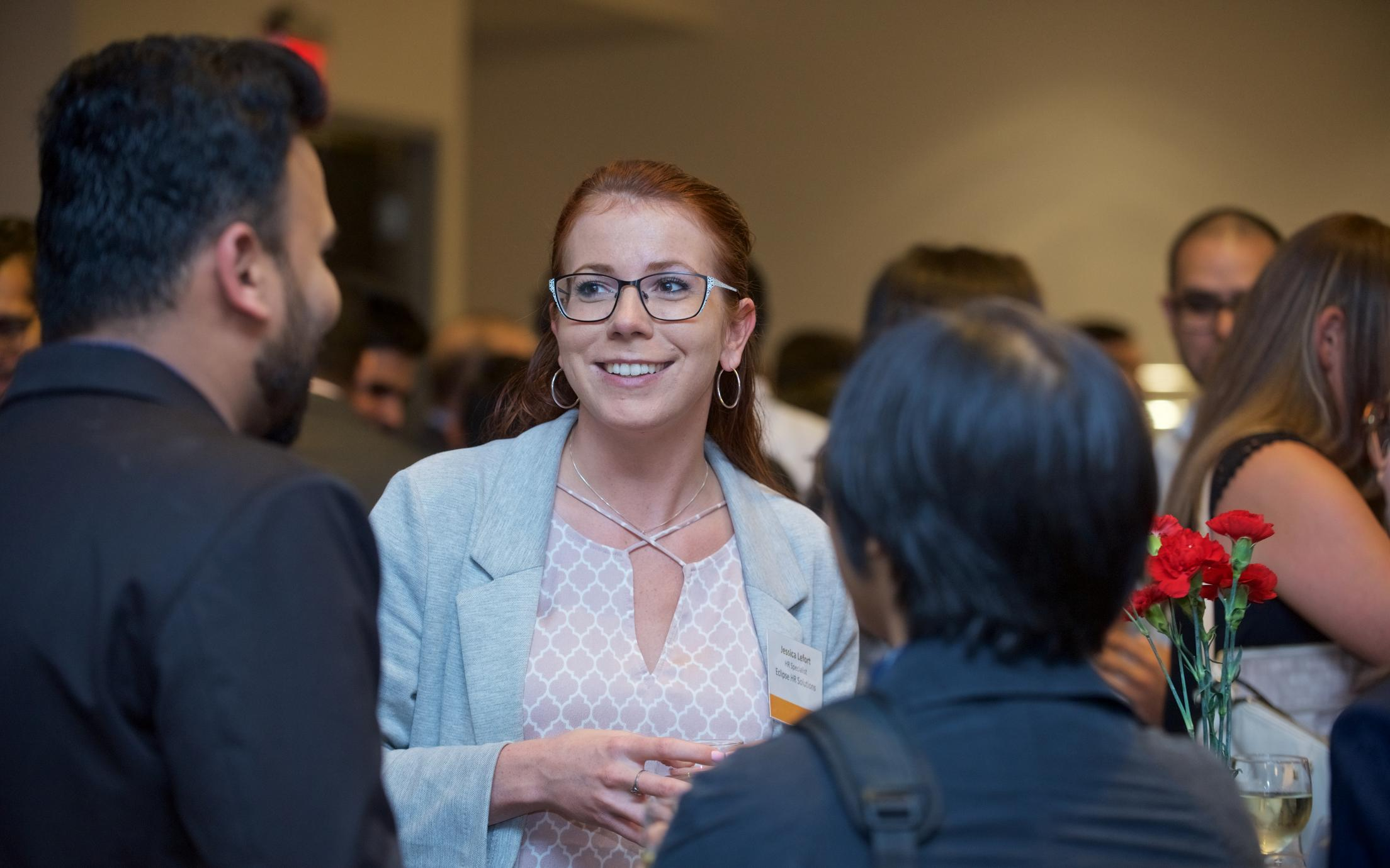 An employer talking to students at an MBA networking event